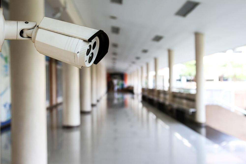 Image of a CCTV camera in a school corridor.